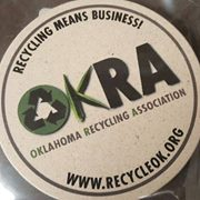 stone coaster with OKRA logo on it
